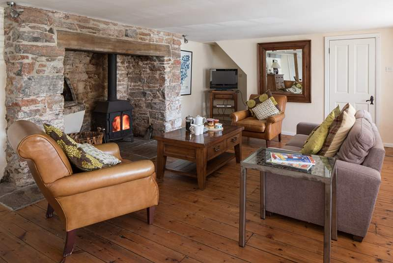 The wood-burner makes this living-room the perfect place to relax and unwind after an action packed day.