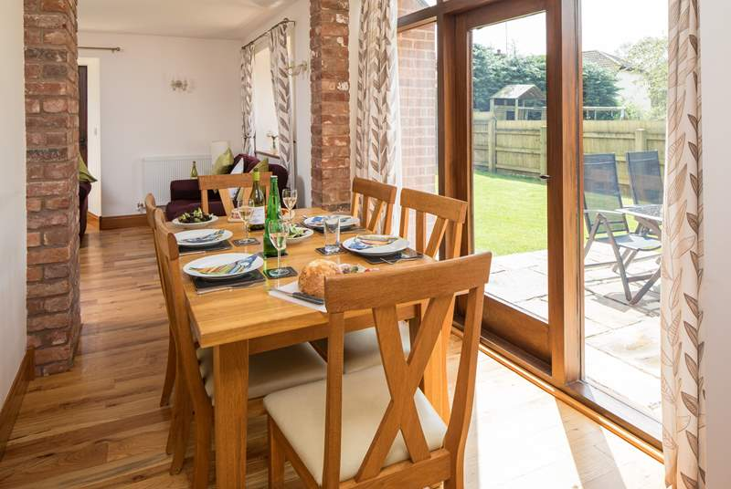 The dining-area has French doors that open onto the patio and fully enclosed garden. The solid oak table and chairs comfortably seat up to six guests.