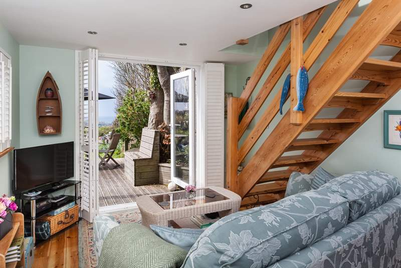 The lovely open plan living-room, has french doors which lead out onto the sunny decked area.