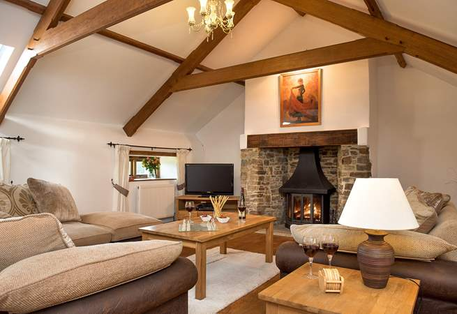 The very spacious sitting-room is situated on the first floor and has a gorgeous wood-burner making this an ideal retreat all year round.