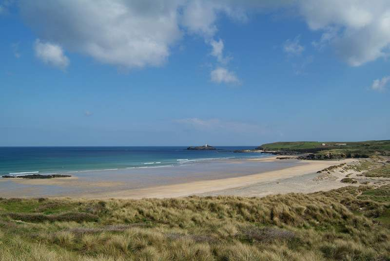 Miles of golden sands stretch between Hayle beach and Godrevy lighthouse, which marks the far end of St Ives Bay.