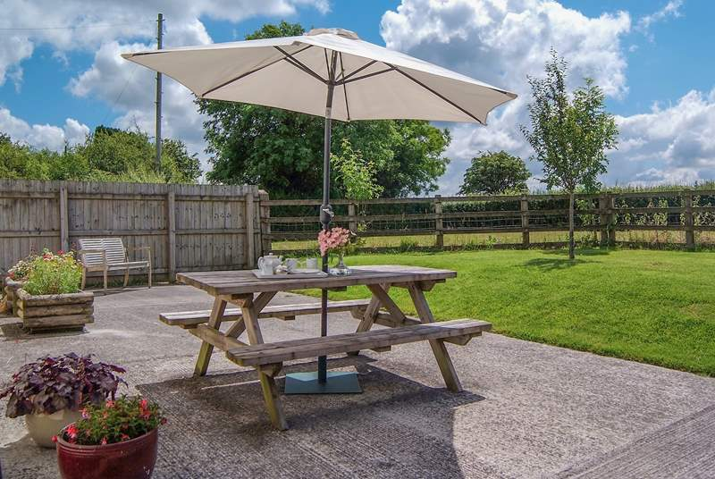 There is a sunny patio and a large fully enclosed garden with a paddock beyond. This place is ideal for young children and guests who wish to bring a dog.