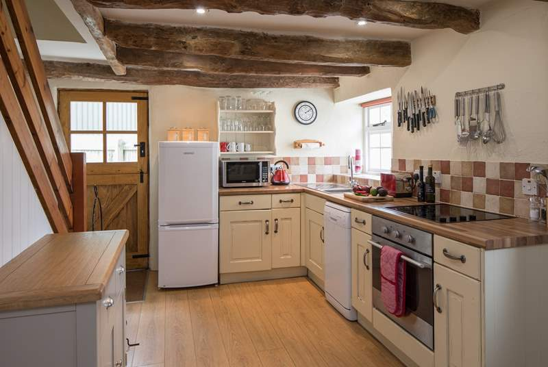 The kitchen is tucked at one end of the open plan ground floor living-area.