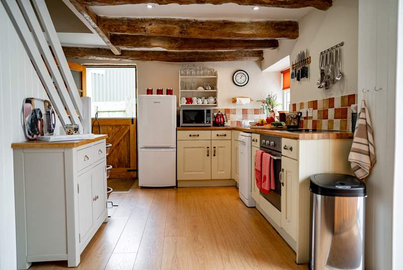 The kitchen benefits from the open plan layout as well as a stable door out to the very private rear garden.