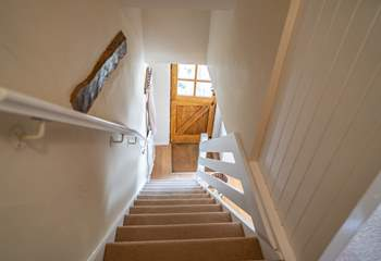 The stairs up to the bedrooms and bathroom.
