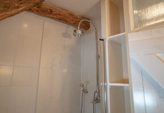 The shower is positioned over the bath with two attachments.