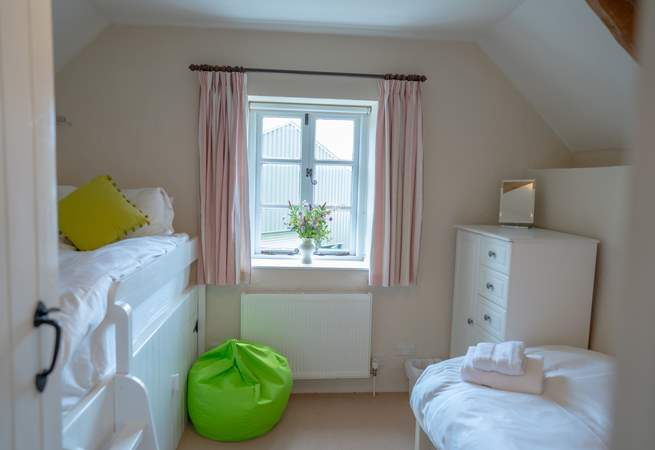 The twin bedroom offers two 3ft beds with space to play and relax.