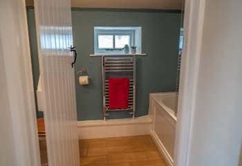 The bathroom is situated on the landing between the two bedrooms.