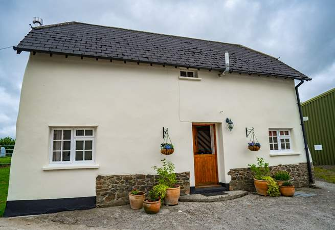 Cherryblossom Cottage sits to one side of the courtyard with parking to the side and a beautifully secluded garden to the rear.