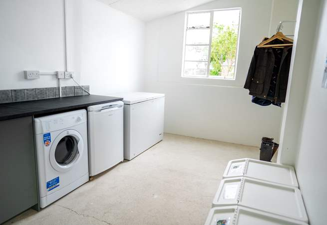 Across the courtyard there is a utility room for storing your body boards or hanging up coats and storing muddy boots.