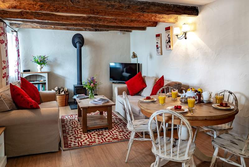 The open plan living makes for a wonderfully sociable holiday, in the winter months the wood burning stove will keep the cottage cosy.