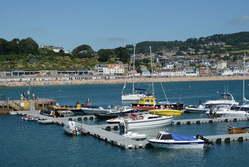 Lyme Regis has plenty going on all year round, fossil history, the iconic Cobb, a lovely beach with summer watersports and lots of shops and delicious places to eat.