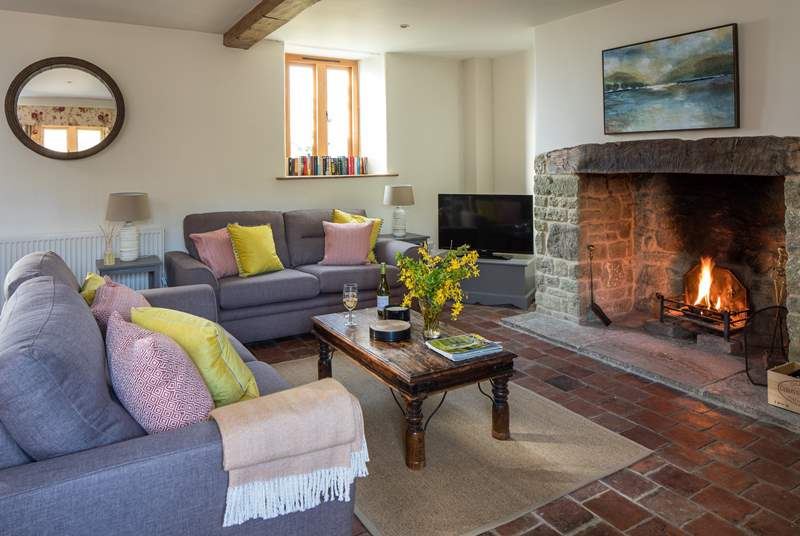 The open fire adds cosy character to this lovely cottage.