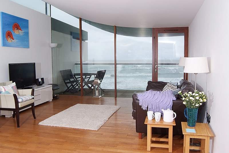 The living-area has a balcony and amazing sea views.