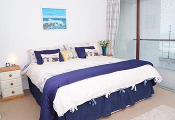 The spacious master bedroom also has a balcony the full length of the room.