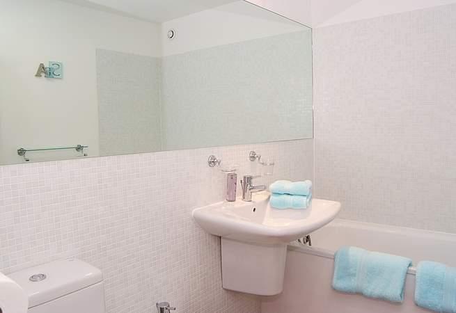 The master bedroom has a large en suite bathroom.