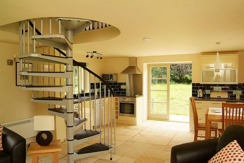 The open plan living-room allows light to pour in.