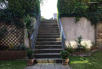 The steps that lead down from the car park to the apartment.