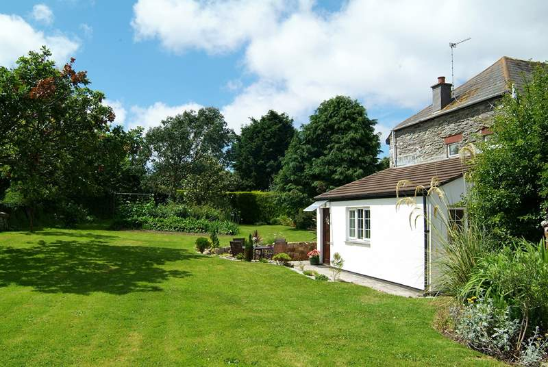 With a pretty, sunny patio outside, the cottage overlooks the beautiful garden.