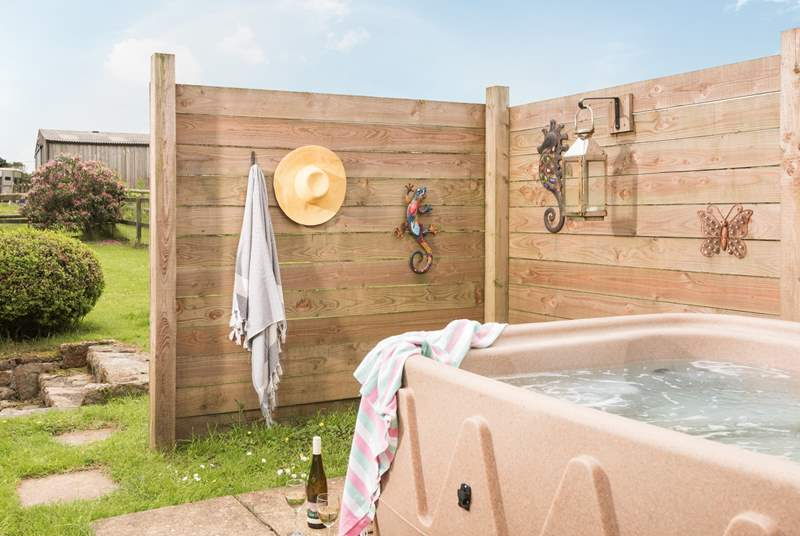 The hot tub is behind the barn and in its own little enclosure so privacy is guaranteed.