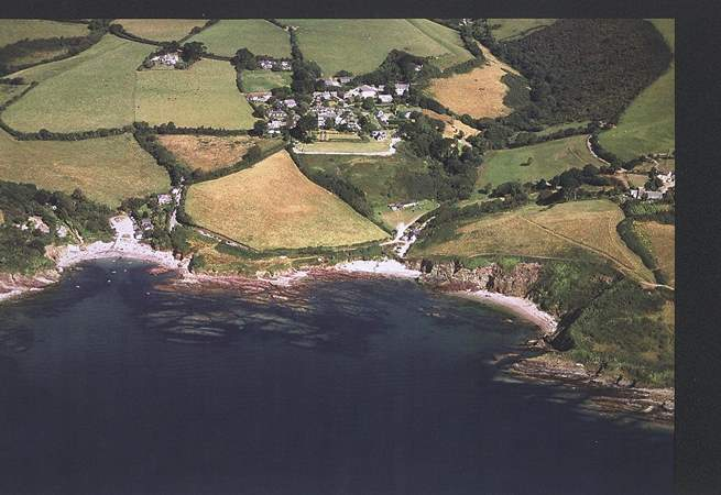 An aerial photograph of Talland Bay, with the beach on the left a few minutes' walk down the hill from Fred's House.