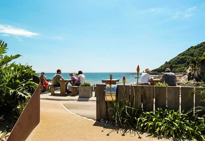 A short stroll down the road to the beach and beach café-  a great place for a bite to eat! (Not the view from the property)