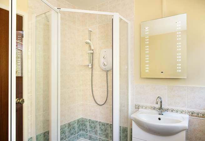 The family bathroom is on the ground floor and has a separate shower cubicle.