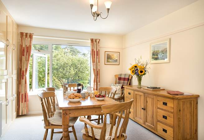 The dining-room looks out onto the gorgeous garden.