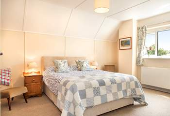 Bedroom Two is lovely and spacious and enjoys views of the countryside and coastline.