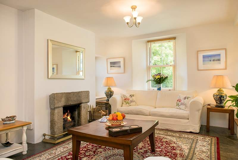 The sitting room has an open fire, making this an ideal retreat all year round!
