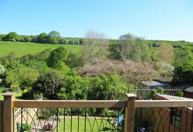 The decking above the garden at the back of the cottage  is a delightful place to sit and enjoy the view right across the valley.