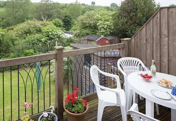 The decking above the garden at the back of the cottage is a relaxing place to sit and enjoy the view right across the valley.