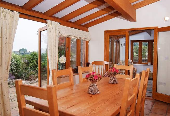 The dining-room links through to a further sun-room, both with French windows to the little garden.