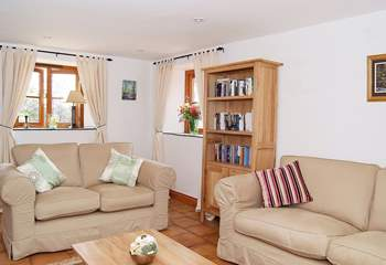 The light and airy sitting-room has a door through to the sun-room.
