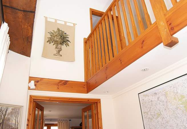 The galleried landing creates space and light in this top class barn conversion.