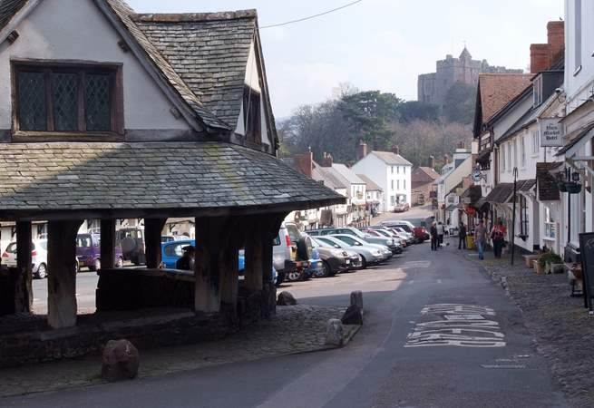The main street of medieval Dunster, with the castle in the distance - now a National Trust property.