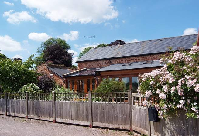 Knights Barton is a fabulous barn conversion with a lovely enclosed cottage garden.