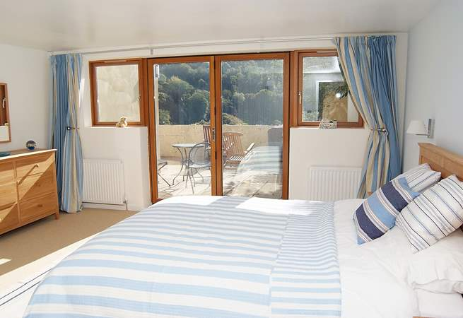 The gorgeous double bedroom also has glazed doors out to the patio.