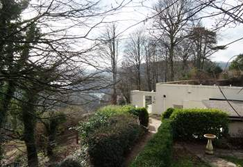 The stepped path down to the property, shown here in winter, with the glint of the River Dart in the background.