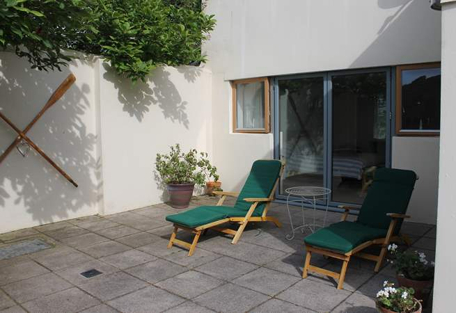 Loungers outside the bedroom (Bedroom 1).