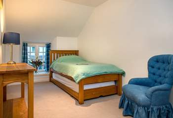 The single bedroom on the first floor is comfortably furnished.
