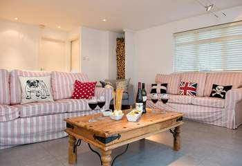 The sitting-room is very spacious and has plenty of room for everyone to relax.