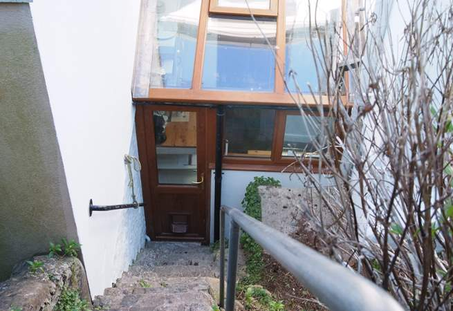 There are three terrace levels in the garden and this last flight of steps goes down to the back door (take care as they are steep).