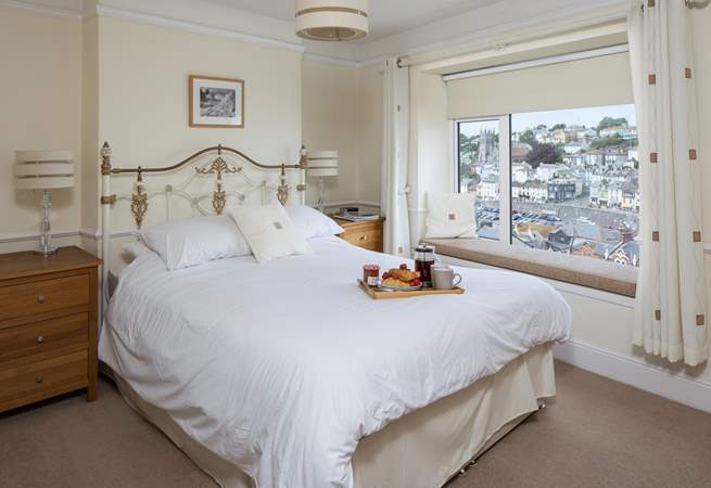Spacious master bedroom with far reaching views out over Brixham harbour and out to sea.