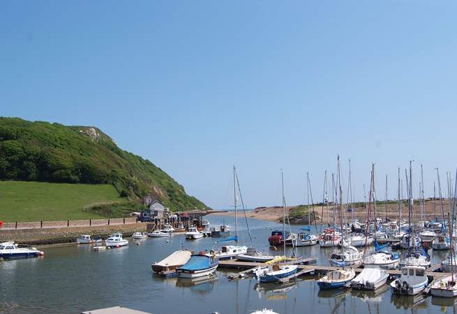 The pretty harbour at Seaton with the cliffs and sea beyond. A very short walk downhill from Little Woodlands (uphill on the way back).