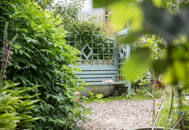 A quiet place to sit in the private garden tucked behind Little Woodlands.