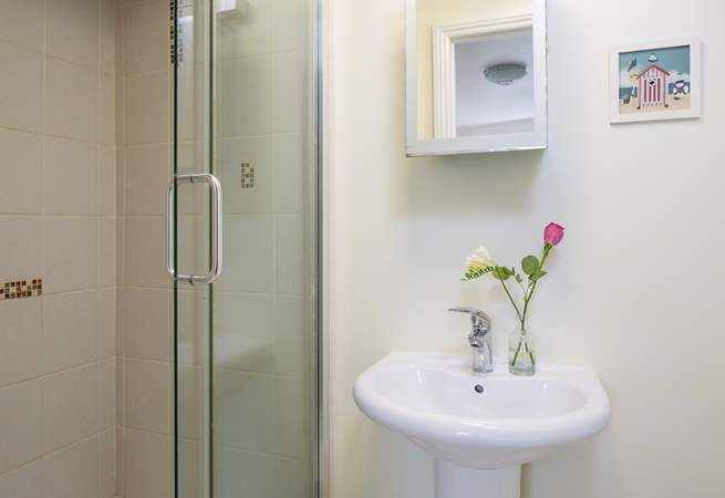 The en suite shower-room has a double size shower cubicle.