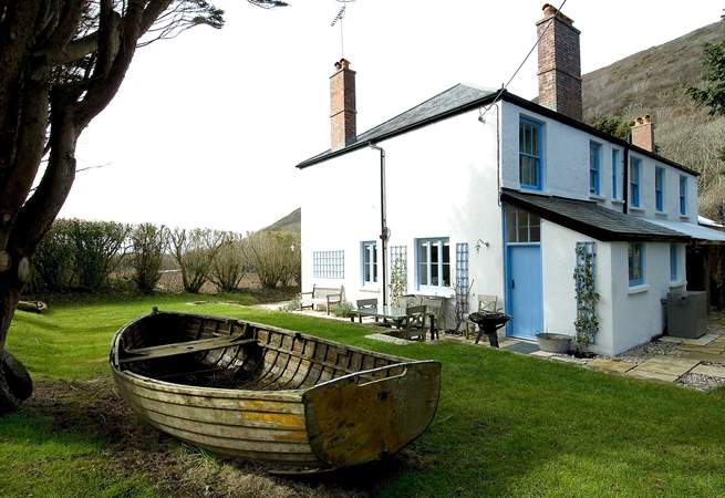 Meadowgate has a delightful garden complete with play boat!