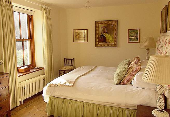 The master bedroom overlooks the valley towards the sea.