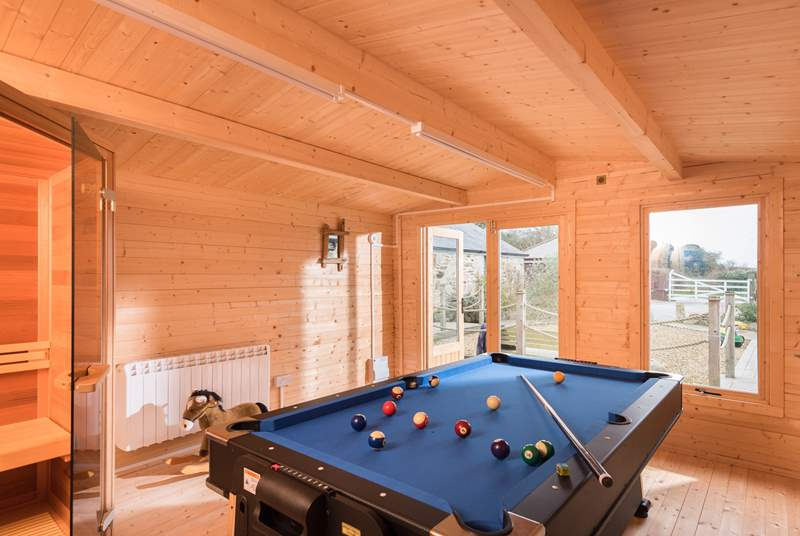 The shared games-room houses a steam-room, and a pool table which can also be turned into an air hockey table.